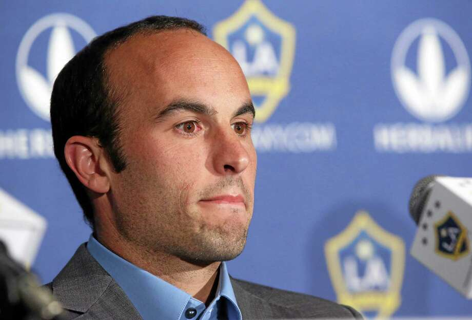 Los Angeles Galaxy forward Landon Donovan announced Thursday that he will retire at the end of the MLS season. Photo: Nick Ut — The Associated Press  / AP