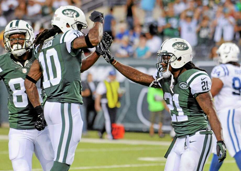 New York Jets running back Chris Johnson (21) celebrates with wide receiver Clyde Gates after scoring a touchdown against the Colts on Thursday. Photo: Bill Kostroun — The Associated Press  / FR51951 AP