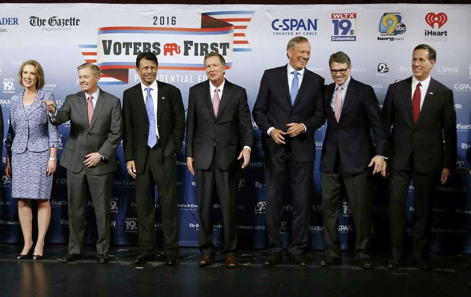 Republican presidential candidates gather on stage before a forum Monday, Aug. 3, 2015, in Manchester, N.H. From left: businesswoman Carly Fiorina, Sen. Lindsey Graham, R-S.C., Louisiana Gov. Bobby Jindal, Ohio Gov. John Kasich, former New York Gov. George Pataki, former Texas Gov. Rick Perry, and former Pennsylvania Sen. Rick Santorum. Photo: AP Photo/Jim Cole / AP