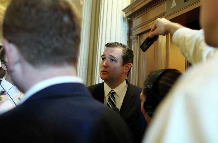 Sen. Ted Cruz, R-Texas, speaks to reporters after the Senate conducted a procedural vote on Planned Parenthood on Monday, Aug. 3, 2015 on Capitol Hill in Washington. The Senate blocked a Republican drive Monday to terminate federal funds for Planned Parenthood, setting the stage for the GOP to try again this fall amid higher stakes. Photo: AP Photo/Lauren Victoria Burke / FR132934 AP