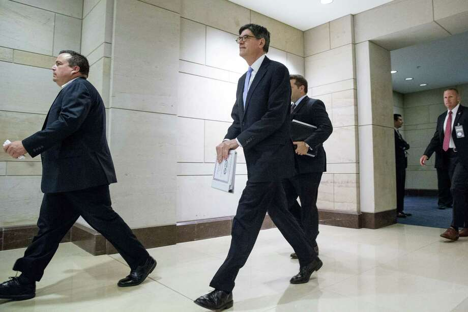 Secretary of Treasury Jacob Lew, center, arrives for a classified briefing for all House members on Capitol Hill in Washington July 22 to speak about the deal reached to curb Iran's nuclear program in exchange for billions of dollars in relief from international sanctions. Photo: AP Photo  / AP