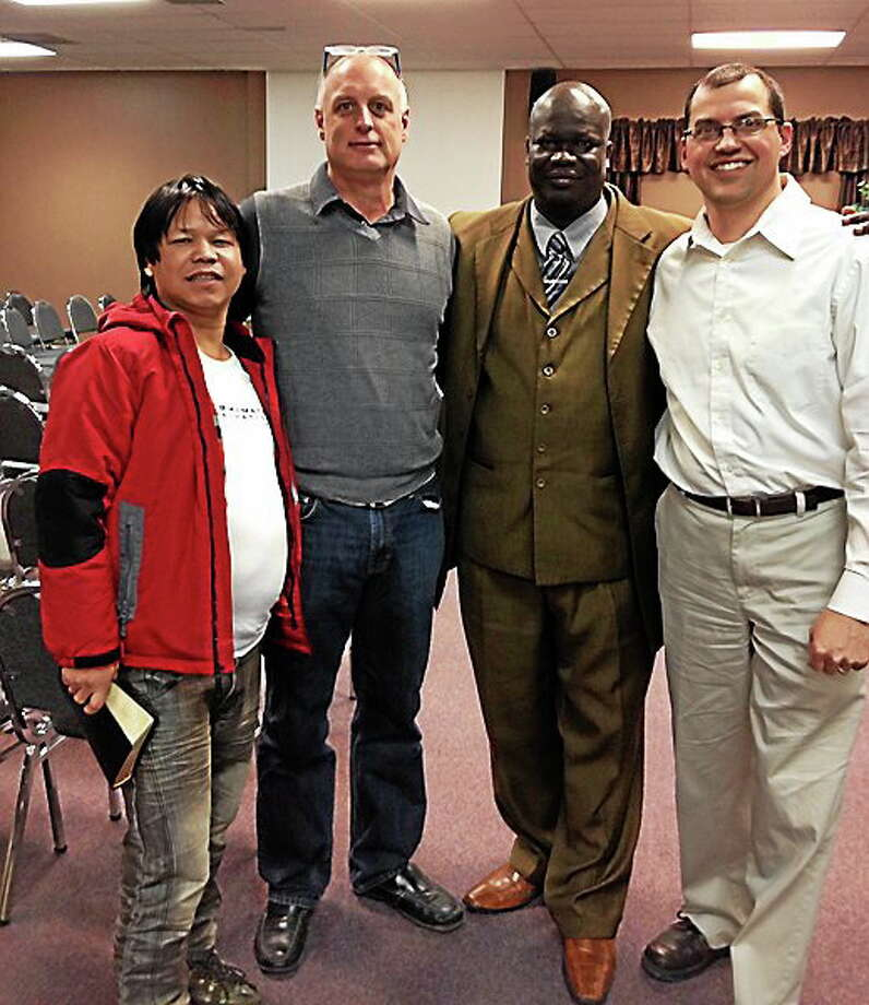 Left to right, Deepak Gerung, lead pastor of Emmanuel International Church; Kevin Zaun, lead pastor of Heartland Community Church; Paul Agamiri, lead pastor of All Nations Assembly of God; and Shawn Stoll, assistant pastor of All Nations Assembly of God, stand together at Heartland Community Church. Photo: Photo Courtesy: Chris Dawes