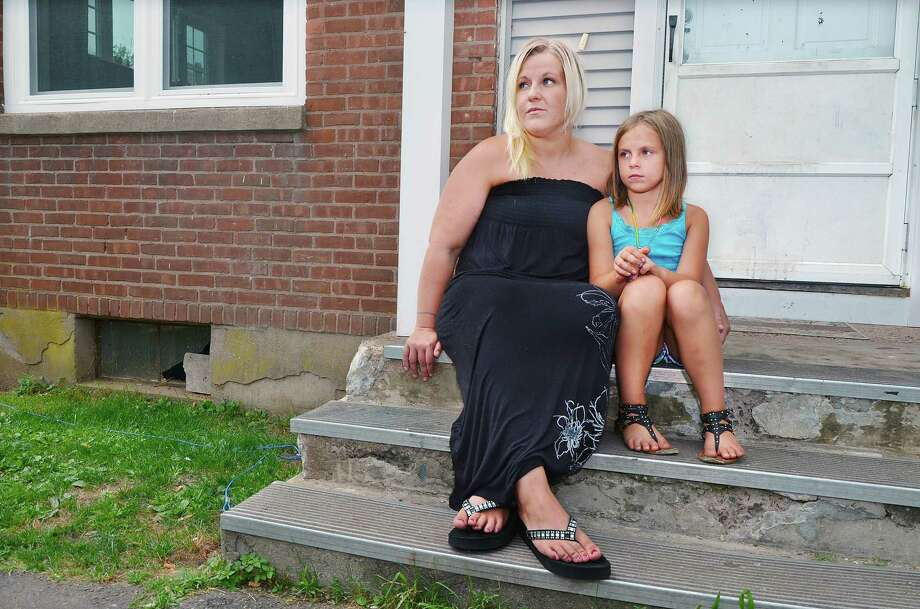 Katie O'Brien with her older daughter Kayden Manzara, 7, received local support to avoid eviction from her Middletown home. O'Brien, mother of two girls, lost her job recently and raised money through the fundraising website, Go Fund Me. O'Brien raised 30 percent of her goal, enough money to cover rent for June and July. Photo: Catherine Avalone - The Middletown Press