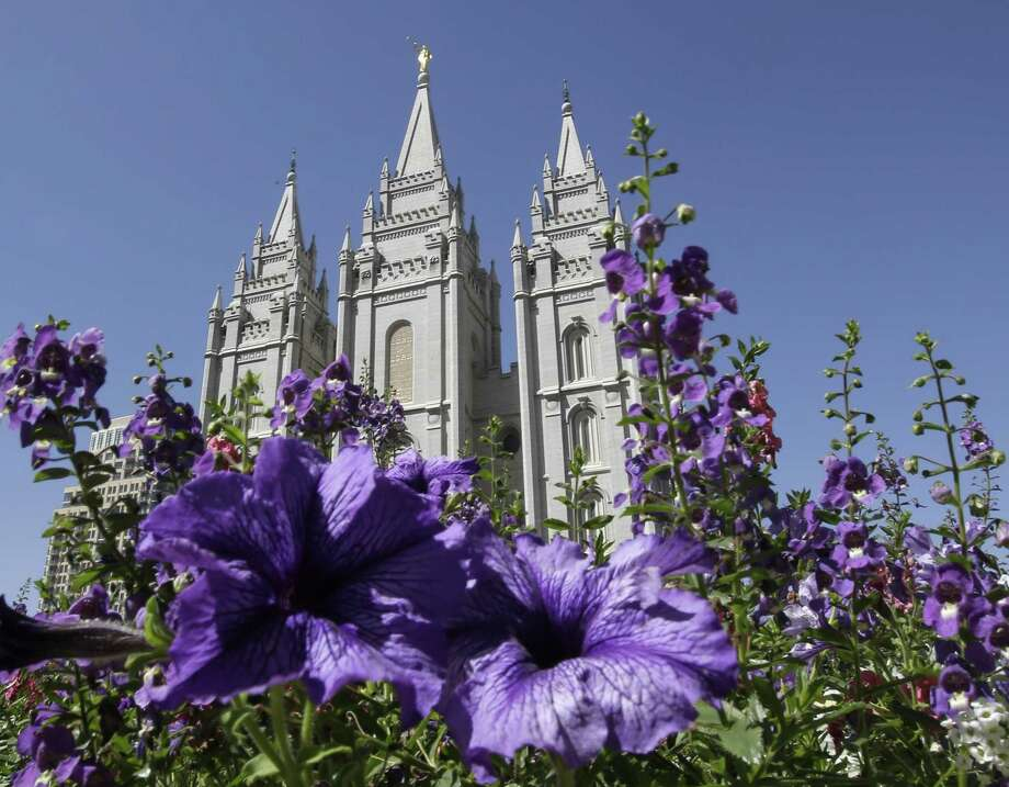 This Sept. 3, 2014, file photo shows flowers blooming in front of the Salt Lake Temple, at Temple Square, in Salt Lake City. Photo: AP Photo/Rick Bowmer, File / AP