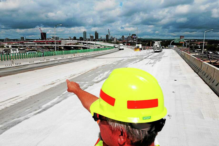 Peter Hvizdak — Register ¬ Connecticut DOT Assistant District Engineer Brian Mercure on the Q-Bridge looking back towards New Haven Tuesday morning July 23, 2013 as crews prepare for a traffic shift this weekend during the  I-95 New Haven Harbor Crossing Corridor Improvement Program. Photo: New Haven Register / ©Peter Hvizdak /  New Haven Register