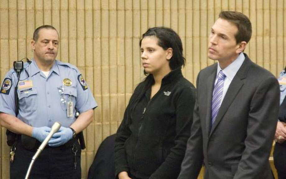 Amanda Bowden, of East Haven, stands with her public defender as she is arraigned in February 2013 in Superior Court, Milford. She was sentenced in March 2014 to 10 months in federal prison, time already served, for threatening a suicidal mass shooting and bombing at Gateway Community College in New Haven. Photo: File Photo — Rich Scinto — New Haven Register