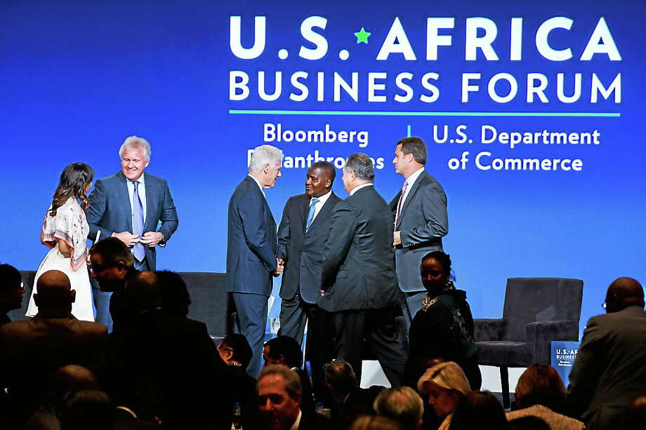 Panelists from left, Phuti Mahanyele, CEO of The Shanduka Group, Jeff Immelt, CEO of General Electric, former President Bill Clinton, Aliko Dangote, president and CEO of the Dangote Group, Andrew Liveris, CEO of The Dow Chemical Company, and Doug McMillon, CEO of Wal-Mart Stores, Inc., gather on stage during the US Africa Business Forum during the US Africa Leaders Summit at the Mandarin Oriental Hotel, Washington on Aug. 5, 2014. Photo: AP Photo/Jacquelyn Martin  / AP
