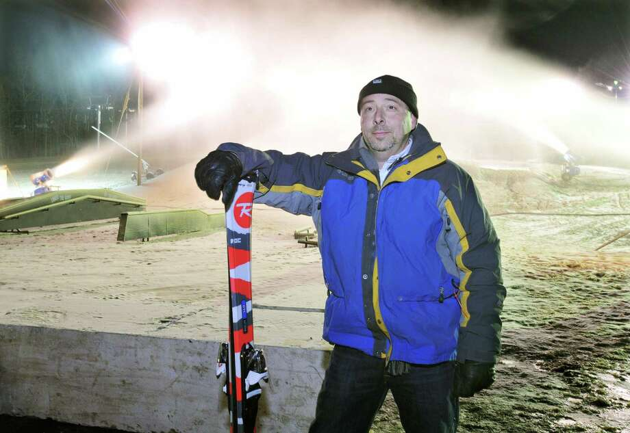 Sean Hayes, owner of Powder Ridge Mountain Resort in Middlefield, with the snow machines pumping out snow on opening day in November 2013. Photo: Catherine Avalone — The Middletown Press  / TheMiddletownPress
