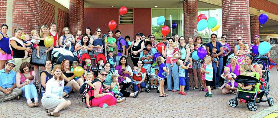 Mothers, babies and health-care professionals gather outside of Middlesex Hospital last year to commemorate World Breastfeeding Week. Photo: File
