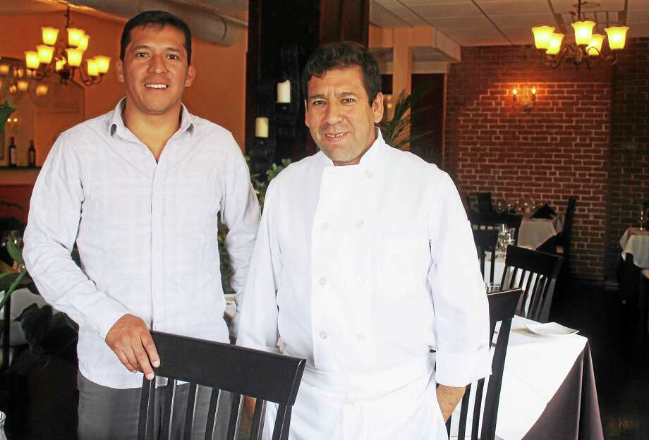 Owner Kebler Guzman, left, and Chef Carlos Guzman, natives of Ecuador, standing in the new dining room at El Pulpo Restaurant and Tapas bar in Middletown's Main Street Mark. Photo: Valerie Bannister — Special To The Press