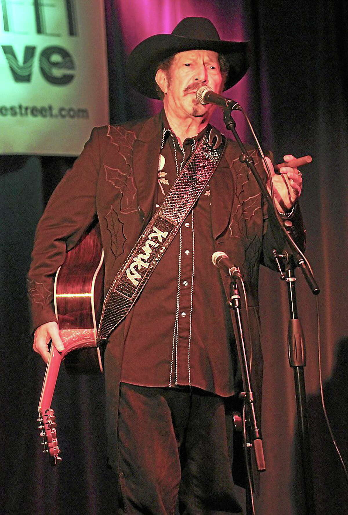 Photo by John Atashian Texas Country singer, songwriter, novelist, humorist, politician and former columnist for Texas Monthly is shown performing on stage during a