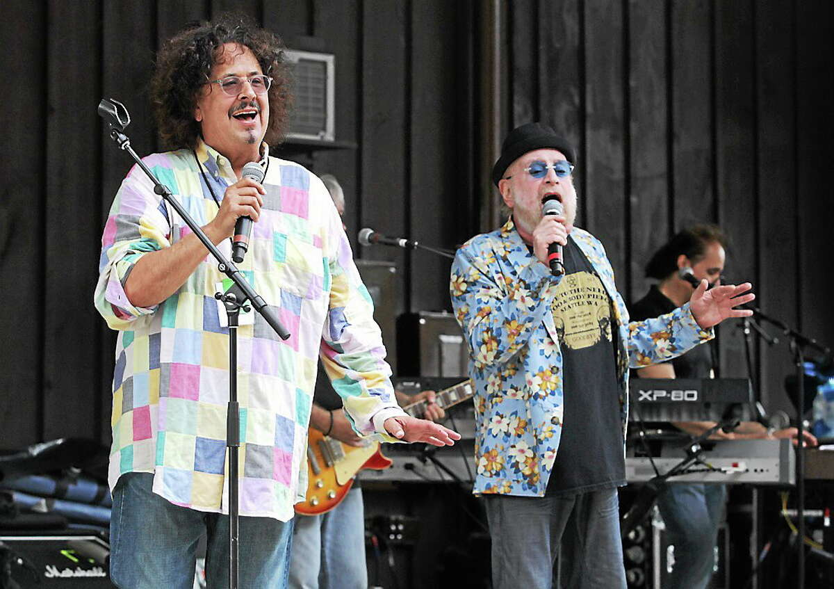 Photo by John Atashian Music partners Mark Volman and Howard Kaylan of The Turtles are shown performing on stage during a concert appearance.