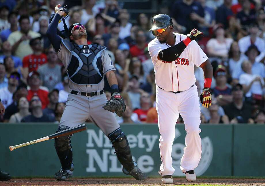 David Ortiz tosses his bat after flying out in the eighth inning on Sunday. Photo: Winslow Townson — The Associated Press  / FR170221 AP