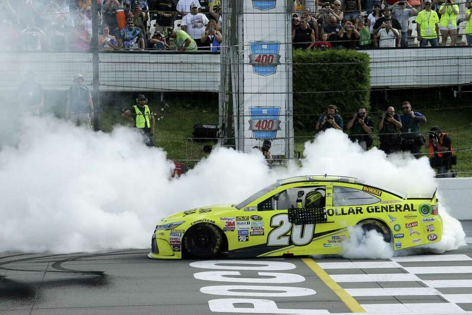 Matt Kenseth smokes his tires after winning the NASCAR Pocono 400 Sunday in Long Pond, Pa. Photo: Matt Slocum — The Associated Press  / AP
