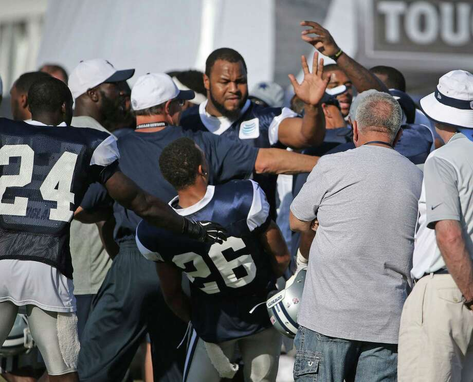 With new player Jeremy Mincy trying to block, Dallas Cowboys wide receiver Dez Bryant, hidden at right, swings at defensive back Tyler Patmon (26) as Bryant confronted Patmon after a rough play during the Cowboys afternoon practice on Sunday. Photo: Paul Moseley — The Associated Press  / Star-Telegram