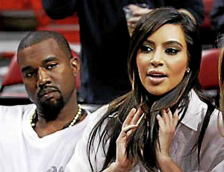 Kim Kardashian, right, and Kanye West, left, are shown before an NBA basketball game between the Miami Heat and the New York Knicks in this Dec, 6, 2012 file photo taken in Miami. Photo: (Alan Diaz — The Associated Press) / AP net