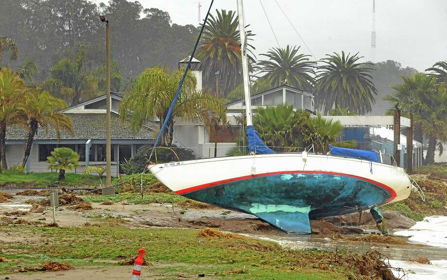 A sailboat washed ashore near a restaurant at Goleta, Calif., Saturday, March 1, 2014. The storm marked a sharp departure from many months of drought that has grown to crisis proportions for the stateís vast farming industry. However, such storms would have to become common to make serious inroads against the drought, weather forecasters have said. (AP Photo/The News-Press, Mike Eliason) Photo: AP / The News-Press