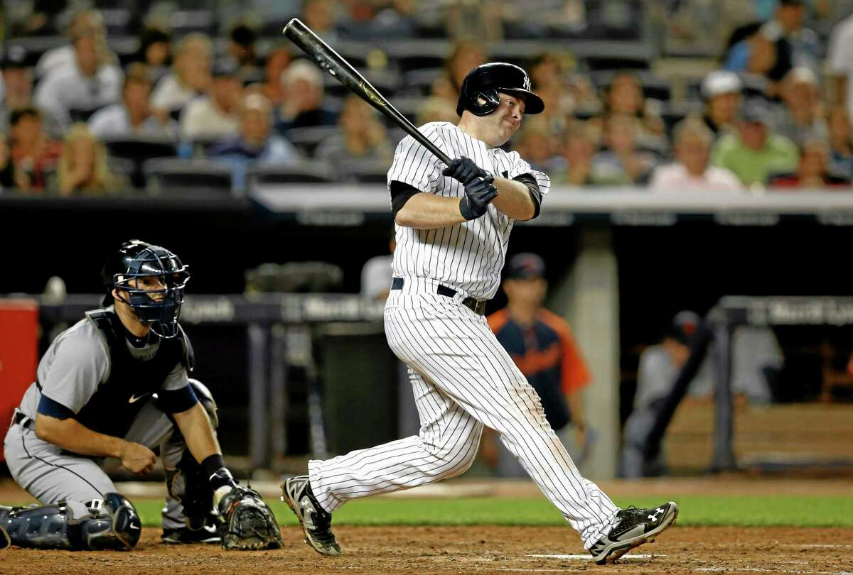 New York Yankees Brian McCann hits a third-inning, RBI single in a baseball game against the Detroit Tigers at Yankee Stadium in New York, Monday, Aug. 4, 2014. (AP Photo/Kathy Willens)