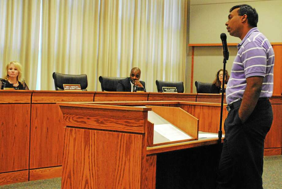 Middletown Parking Director Geen Thazhampallath speaks during questions to directors in Council Chambers on Aug. 4. Photo: Viktoria Sundqvist — The Middletown Press