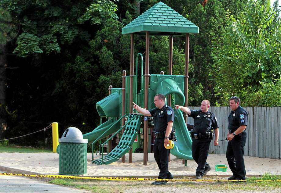 Kentwood Police investigate a stabbing that occurred in a playground in Pinebrook Village, in Kentwood, Mich., on  Aug. 4, 2014.   Police say a 12-year-old boy has stabbed a 9-year-old boy at the playground in western Michigan, sending the child to a hospital.   Police also didn't immediately release detail on the condition of the wounded child. The older boy was taken into custody for questioning by police. (AP Photo/The Grand Rapids Press, Joel Bissell) ALL LOCAL TELEVISION OUT; LOCAL TELEVISION INTERNET OUT Photo: AP / MLive.com