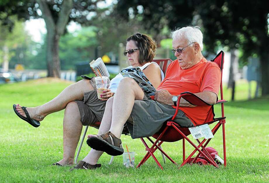 "Middletown resident Bruce Harvey reads People Magazine and his wife, Judy, is engrossed in ""Panic"" by Jeff Abbott. Photo: Middletown Press   / TheMiddletownPress"