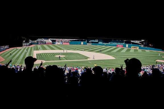 Fans watch the Oakland Athletics against the Cleveland Indians at the Oakland Alameda Coliseum in Oakland on Sunday, July 16, 2017. The Athletics won 7 to 3.
