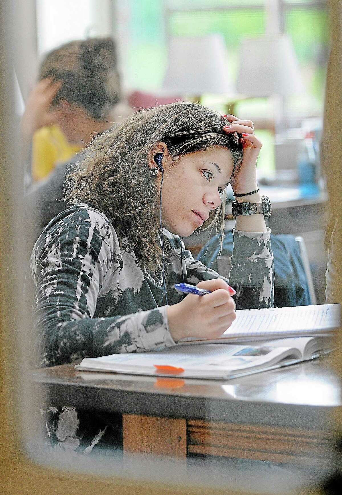 Wesleyan University freshman, Vanessa Bernard, of Mass. studies for a final exam for a Introduction to Pyschology class at the Olin Memorial Library in Middletown.
