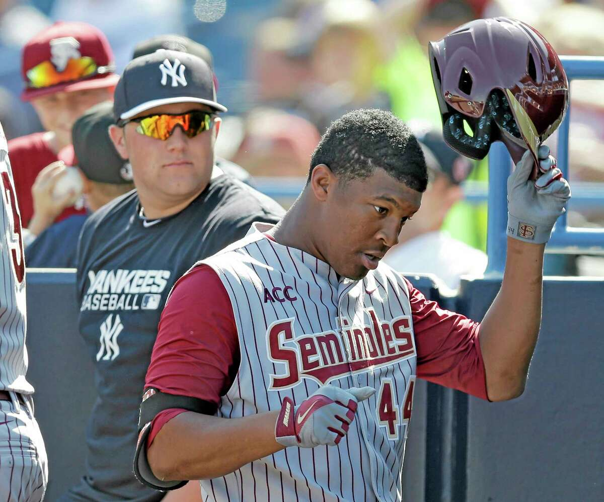 Florida State's Jameis Winston takes off his helmet after grounding out during a spring training exhibition game against the New York Yankees in February in Tampa, Fla.