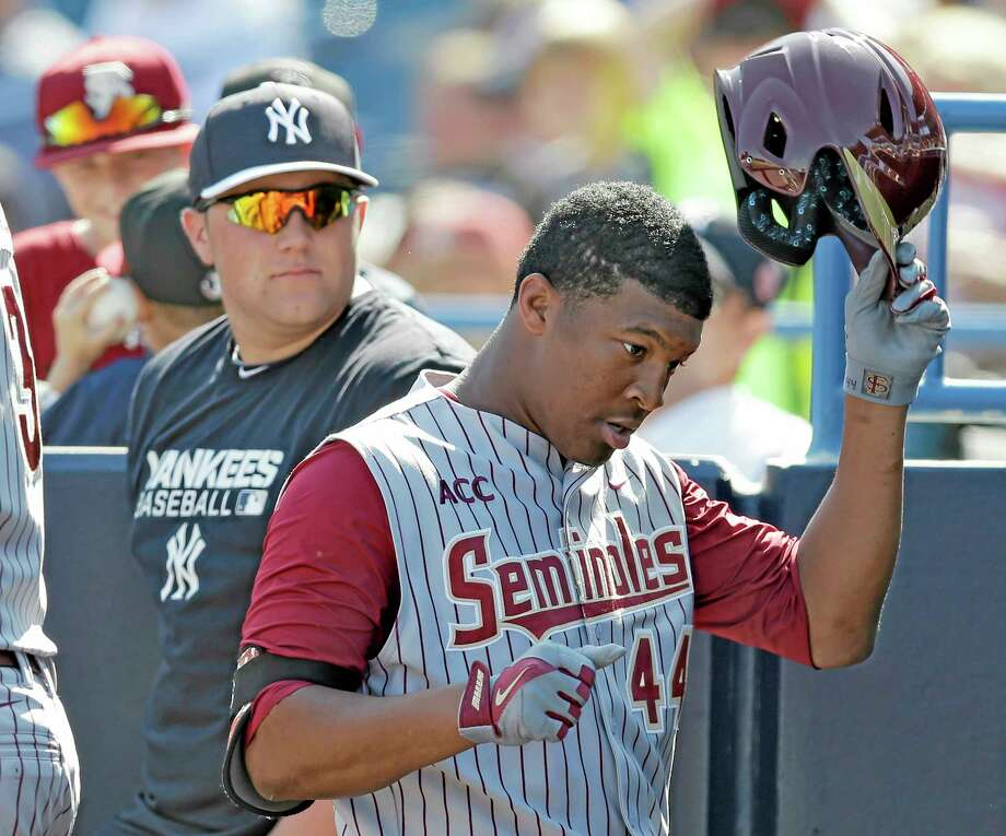Florida State's Jameis Winston takes off his helmet after grounding out during a spring training exhibition game against the New York Yankees in February in Tampa, Fla. Photo: Chris O'Meara — The Associated Press  / AP
