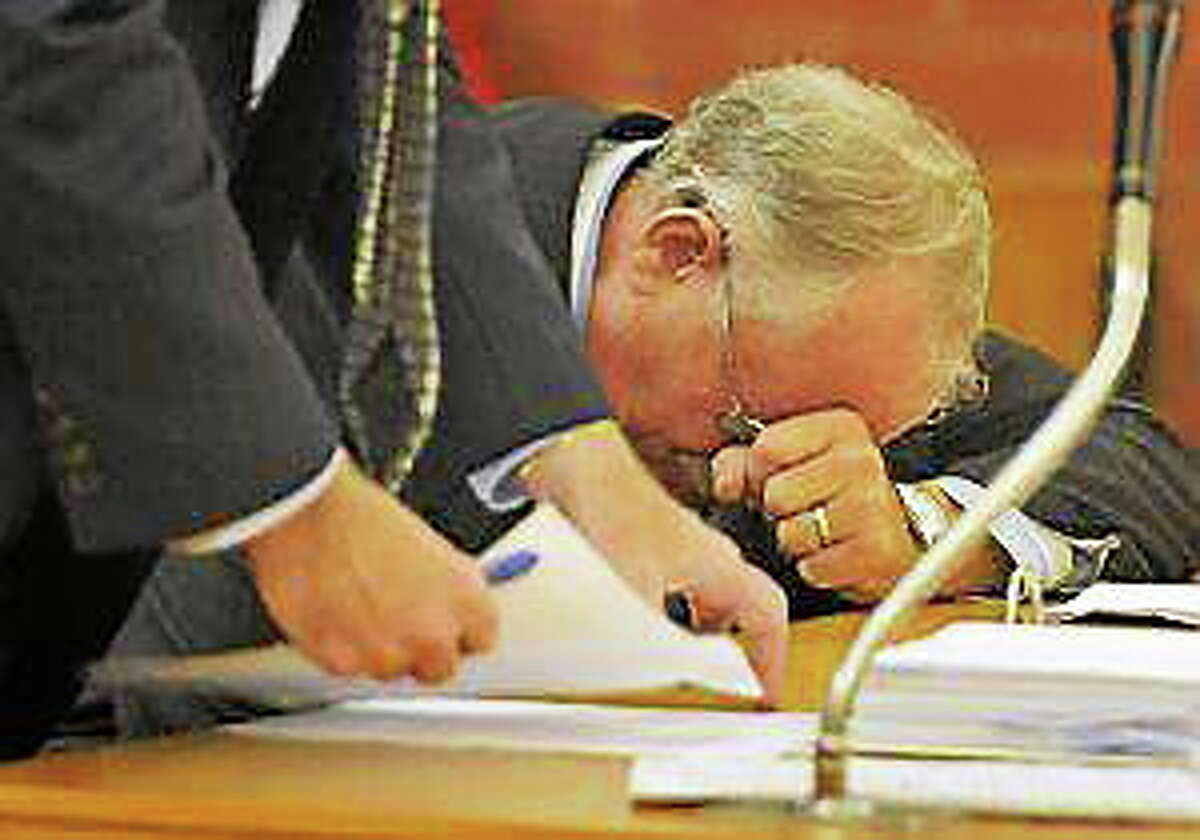 Trucking company owner David Wilcox, right, is overcome with emotion after giving a statement to his attorney, Ray Hassett, left, to read during his sentencing in Hartford Superior Court Wednesday. Wilcox was sentenced to 10 years, suspended after six, for insurance fraud, manslaughter and assault in the 2005 fiery crash that killed four people and injured 11 on Avon Mountain.