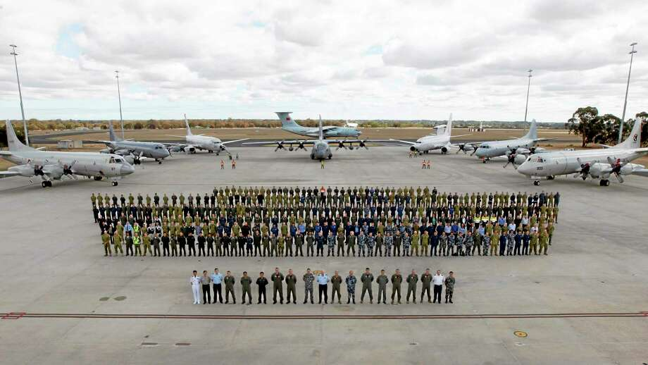 "In this photo taken April 29, 2014, provided by the Australia Defence Force, multinational air-crew and aircraft involved in operation ""Southern Indian Ocean"" are assembled for a photo at RAAF Base Pearce, in Perth, western Australia. Seven nations, including Australia, New Zealand, the U.S., South Korea, Malaysia, China and Japan, have flown daily search missions over the southern Indian Ocean in the massive multinational hunt for the missing Malaysia Airlines Flight 370. Photo: AP Photo/Australian Defence Force, Cpl. Nicci Freeman   / Australian Defence Force"