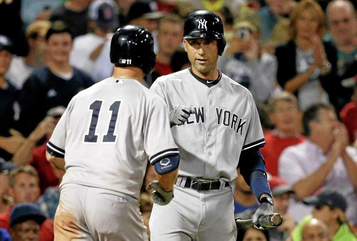 New York Yankees' Brett Gardner, left, celebrates with Derek Jeter, right, after Gardner hit a home run in the sixth Sunday.