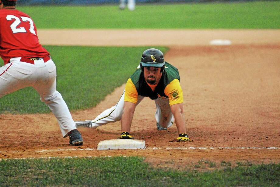 Jimmy Zanor — Middletown Press RCP's Tommy Seaver slides back to first base against Cheshire in the state finals series. RCP received one of the nation's six at-large bids into this week's regional tournament. Photo: Journal Register Co.