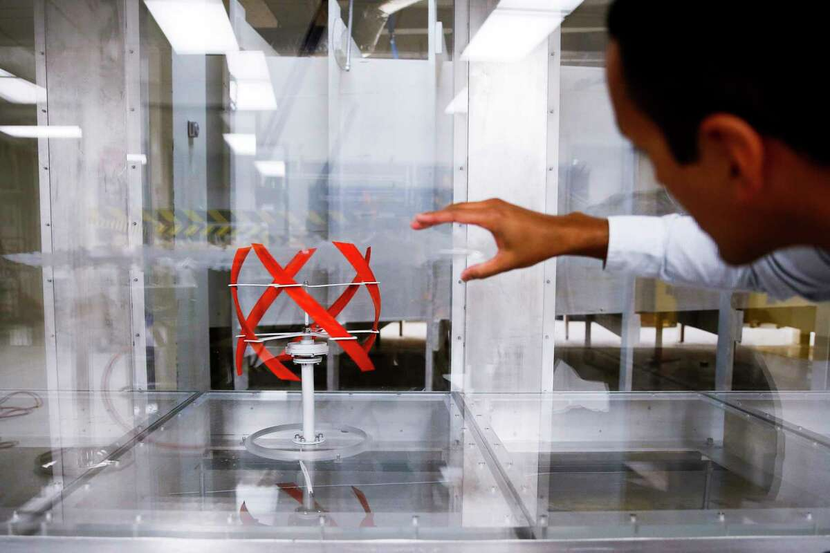 University of Houston assistant professor of mechanical engineering Dr. Daniel Araya watches a stream of smoke in a wind tunnel interact with a 3D printed, helical shaped wind turbine model designed at UH Friday, Aug. 11, 2017 in Houston. ( Michael Ciaglo / Houston Chronicle )