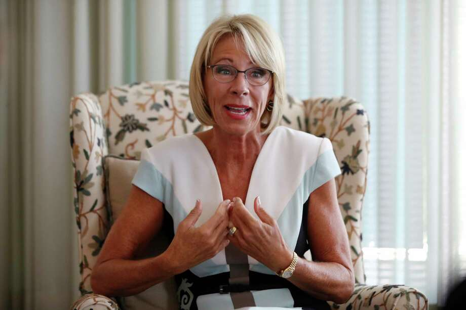 In this Aug. 9, 2017, photo, Education Secretary Betsy DeVos is interviewed by The Associated Press in her office at the Education Department in Washington. It's been six months since her bruising Senate confirmation battle, and DeVos remains highly divisive.(AP Photo/Jacquelyn Martin) Photo: Jacquelyn Martin, STF / Copyright 2017 The Associated Press. All rights reserved.