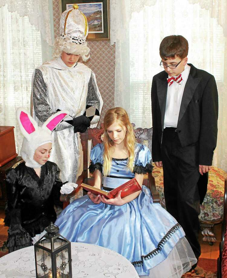 "Submitted photo - Madhatters  Emma Green of Madison as Alice, Jacob Olsen of Old Lyme as Lewis Carroll, Michael Gingras of Ivoryton as White King and Danielle McCarthy of Old Lyme as the White Rabbit, in a rehearsal photo for ""Alice, Through the Looking Glass,"" a show being staged by the Madhatters Theatre Company to benefit the Valley Shore animal shelter. Photo: Journal Register Co."