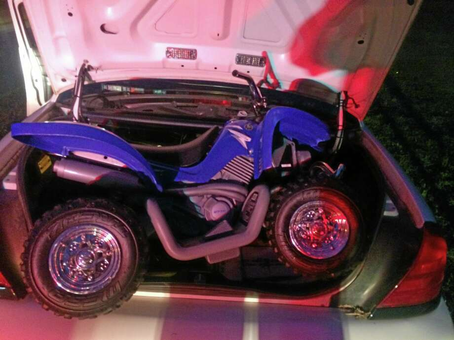 This Sunday, Aug. 3, 2014 photo provided by the Westchester County police in White Plains, N.Y. shows the toy ATV used by a 6-year-old boy to drive onto the Bronx River Parkway. Several drivers formed a slow-moving shield around the boy on his battery-powered toy and got him safely off the roadway. (AP Photo/Westchester County Police) Photo: AP / Westchester County Police