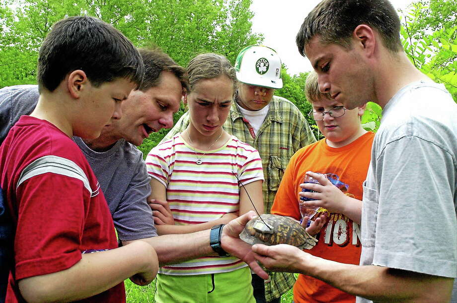Dennis Quinn, right, shows a turtle shell during a Connecticut BioBlitz at the CREC Two Rivers Magnet School in East Hartford. Photo: ASSOCIATED PRESS  / AP
