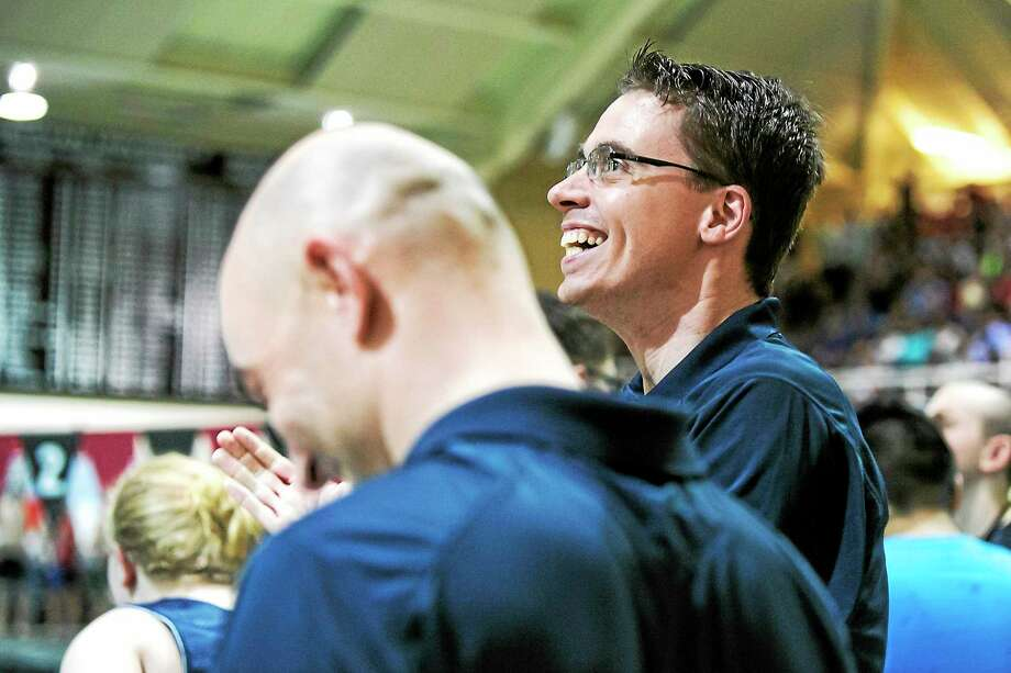 File photo Middletown High Swim Coach Trevor Charles, right, is the founder of diversity day. Photo: Journal Register Co.