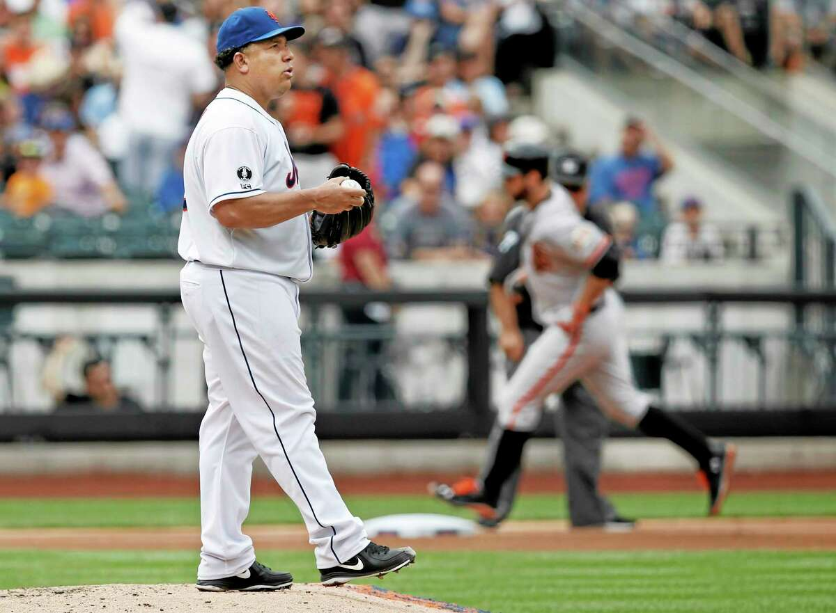 New York Mets starting pitcher Bartolo Colon looks toward the outfield as the Giants' Brandon Belt trots past him after hitting a fourth-inning solo home run Sunday.