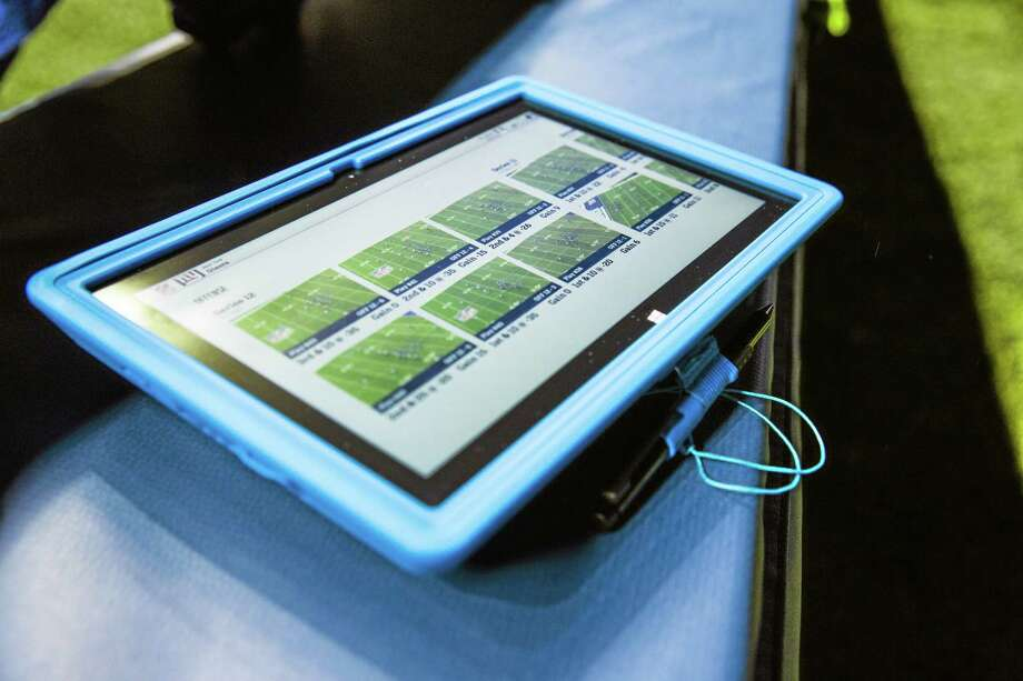 Tablets that will be allowed for the first time on the sideline of NFL football games this season. Photo: The Associated Press  / Microsoft