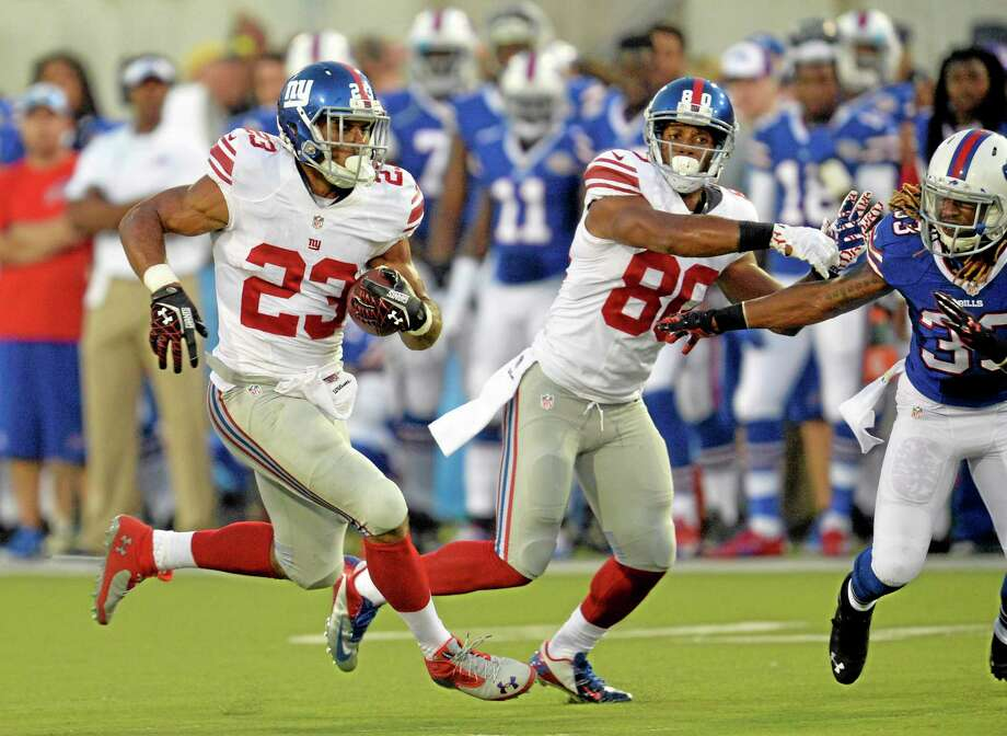New York Giants running back Rashad Jennings (23) runs the ball in the first quarter against the Buffalo Bills Sunday. Photo: David Richard — The Associated Press  / FR25496 AP