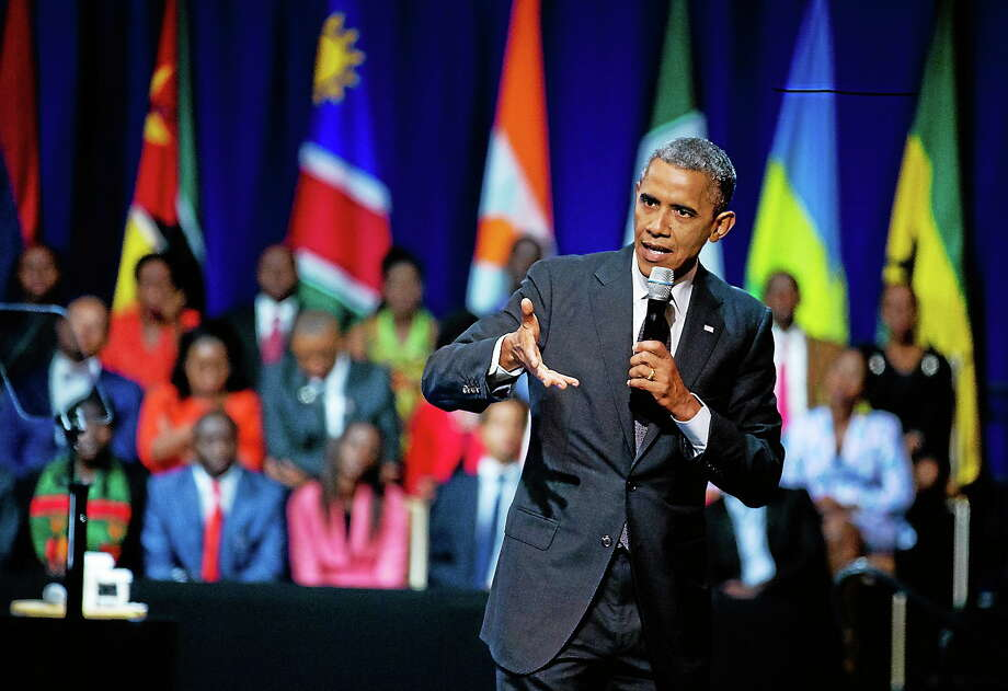 President Barack Obama speaks to participants of the Presidential Summit for the Washington Fellowship for Young African Leaders in Washington on July 28, 2014, during a town hall meeting. It is the lead-up event to an inaugural U.S.-Africa Leaders Summit in August, the largest gathering any U.S. President has held with African heads of state. Photo: AP Photo/Manuel Balce Ceneta  / AP