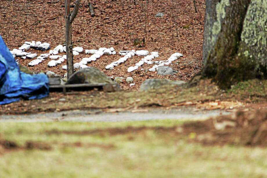 """People in recovery put up the word """"Faith"""" with stones. (Shako Liu-The Register Citizen) Photo: Journal Register Co."""
