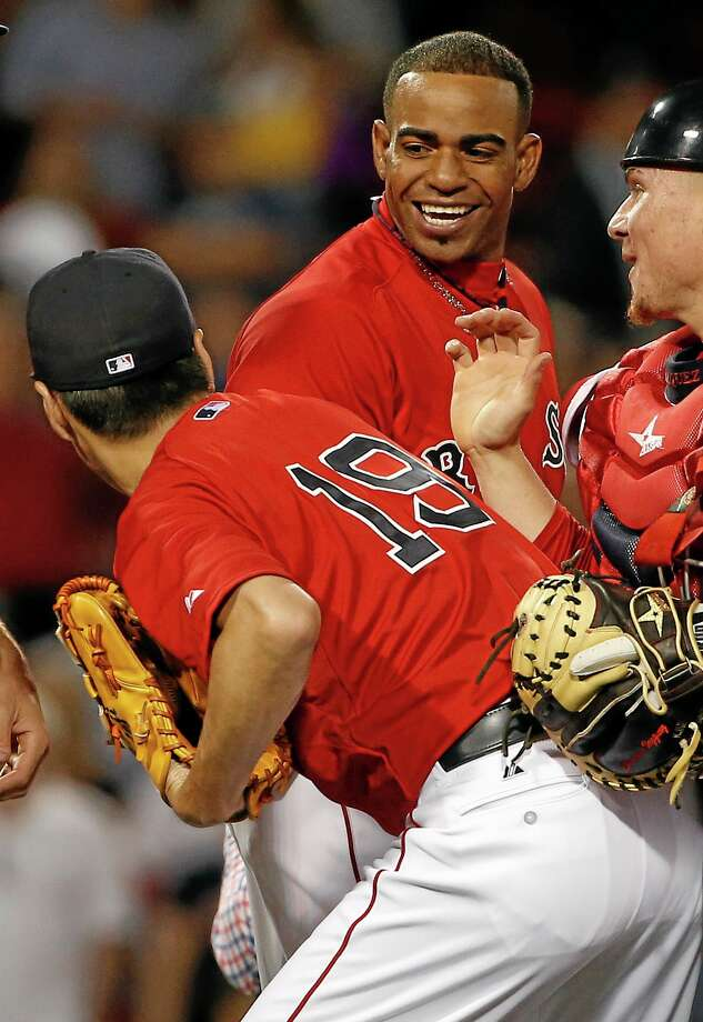 Winslow Townson - Assocated Press Boston Red Sox's Yoenis Cespedes smiles at relief pitcher Koji Uehara, of Japan, after the Red Sox defeated the New York Yankees 4-3 at Fenway Park. Photo: AP / FR170221 AP