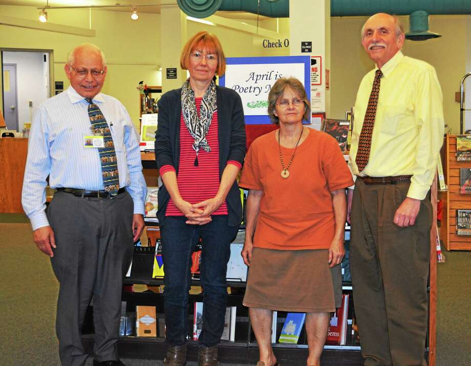 Ann Smith, Susan Honer and Vincent Juliano, assistant director of Russell Library, were honored by the Connecticut Librarian Association while Arthur Meyers, director of Russell Library, far left, was honored by the Middlesex County Bar. Photo: Kaitlyn Schroyer — The Middletown Press