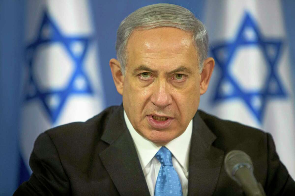 Israeli Prime Minister Benjamin Netanyahu speaks to the media during a press conference at the defense ministry in Tel Aviv, Israel, Saturday Aug. 2, 2014. Netanyahu warned Hamas on Saturday that it will
