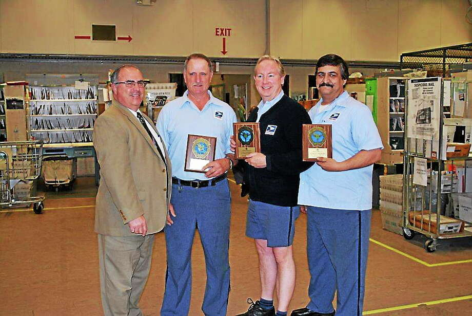 District Manager David Mastroianni presented Million Mile Club awards to Paul Bushka, Carl Calhoun and Anthony Skitromo at the Middletown Post Office on Tuesday. Photo: Submitted Photo