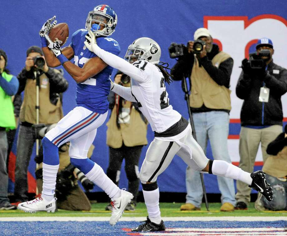 New York Giants receiver Rueben Randle catches a touchdown pass during Nov. 10, 2013 game against the Oakland Raiders in East Rutherford, N.J. Photo: Bill Kostroun — The Associated Press File Photo  / FR51951 AP