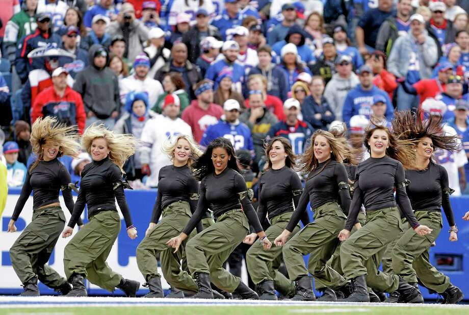 In this Nov. 17, 2013, photo, Buffalo Bills cheerleaders perform during the Bills' NFL football game against the New York Jets in Orchard Park, N.Y. The Bills will be playing without the support of their official cheerleaders this year. Stephanie Mateczun, whose company manages the Buffalo Jills cheerleading squad, said Thursday, April 24, 2014, she has suspended operations through at least the end of the season. The decision was made two days after five former Jills filed a lawsuit complaining they worked hundreds of hours for free, and were subjected to groping and sexual comments. (AP Photo/Heather Ainsworth) Photo: AP / FR120665 AP